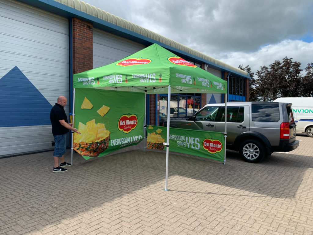 Fully branded gazebo with full and half walls